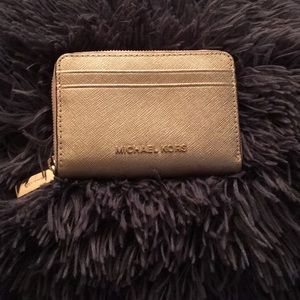 A Gold Michael Kors ZIP Around Wallet